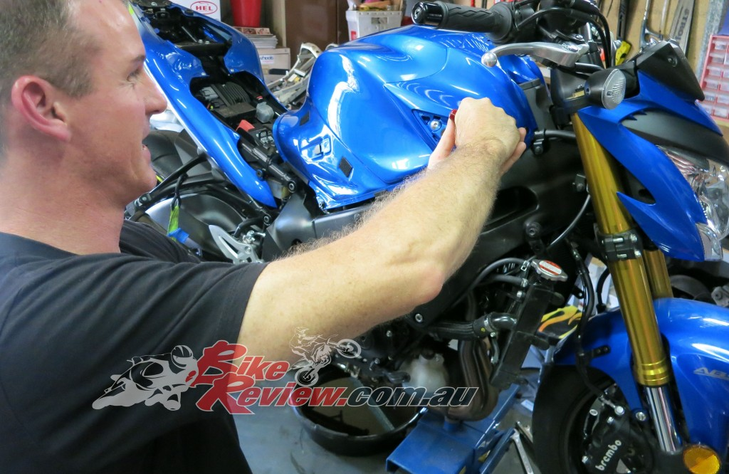 While the oil was draining the bodywork was removed so we could check the airfilter and clean under it all due to the roadwork dirt encountered on the MotoGP trip.