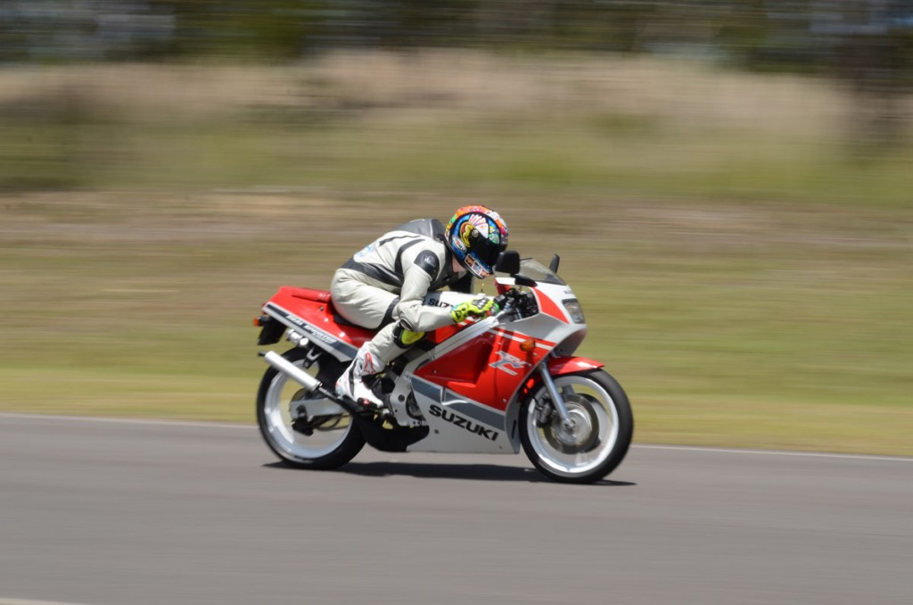 Jamie tucked in at full noise in top gear on the mint RGV250...