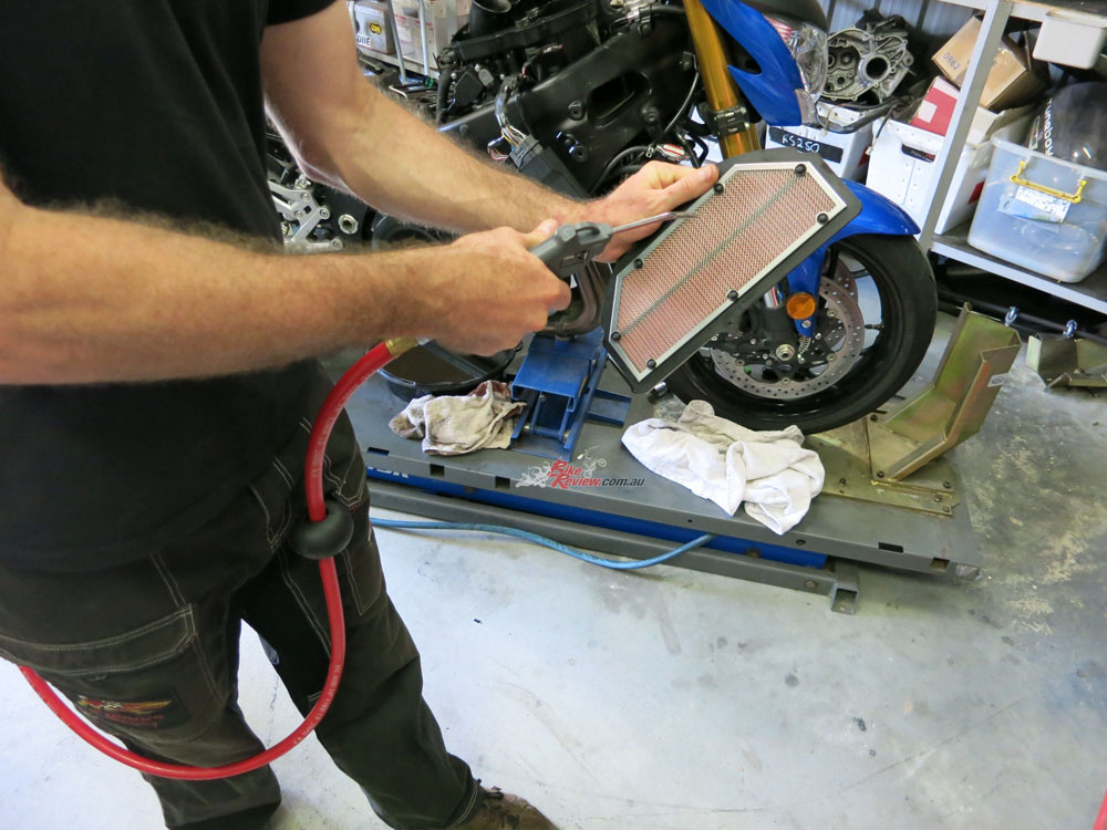 The airfilter was tapped face down on the floor, which dislodged a hell of a lot of dirt and sand and small rocks. Then it was fully blown out with compressed air. Next service we will fit a new reusable performance filter.