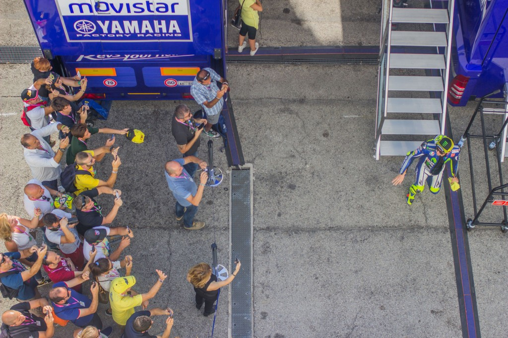 Lucky people, Rossi's fans would think. They can wait for Valentino not from behind the truck, but close to the Yamaha box entrance.
