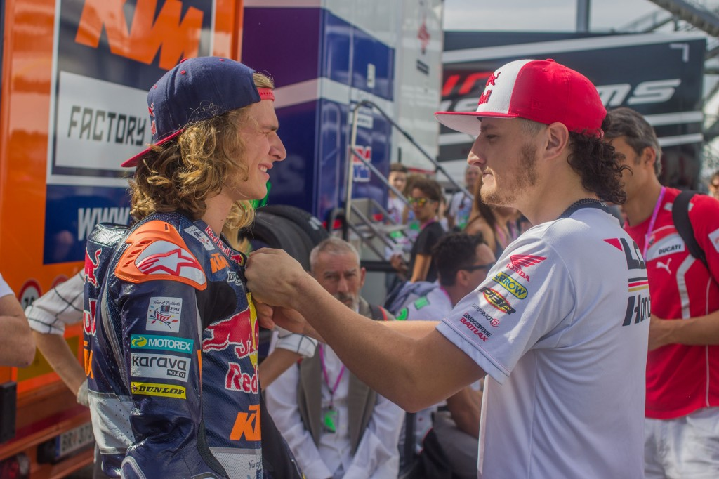 Almost time for the Moto3 race. MotoGP rider Jack Miller, in his first year in the top class, cheers up Karel Anika right outside the Red Bull KTM box. One year ago he was battling for the championship with that same team.