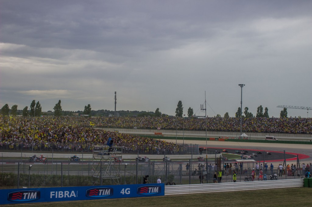 First lap of the MotoGP race. After a sunny morning, too many clouds arrived. It will soon start to rain, transforming this in a messy race, because it will soon stop and the track will dry relatively quickly. Marc Marquez will win ahead of Bradley Smith and Scott Redding. Small-fish-Rossi will finish fifth. Shark-Lorenzo will crash.