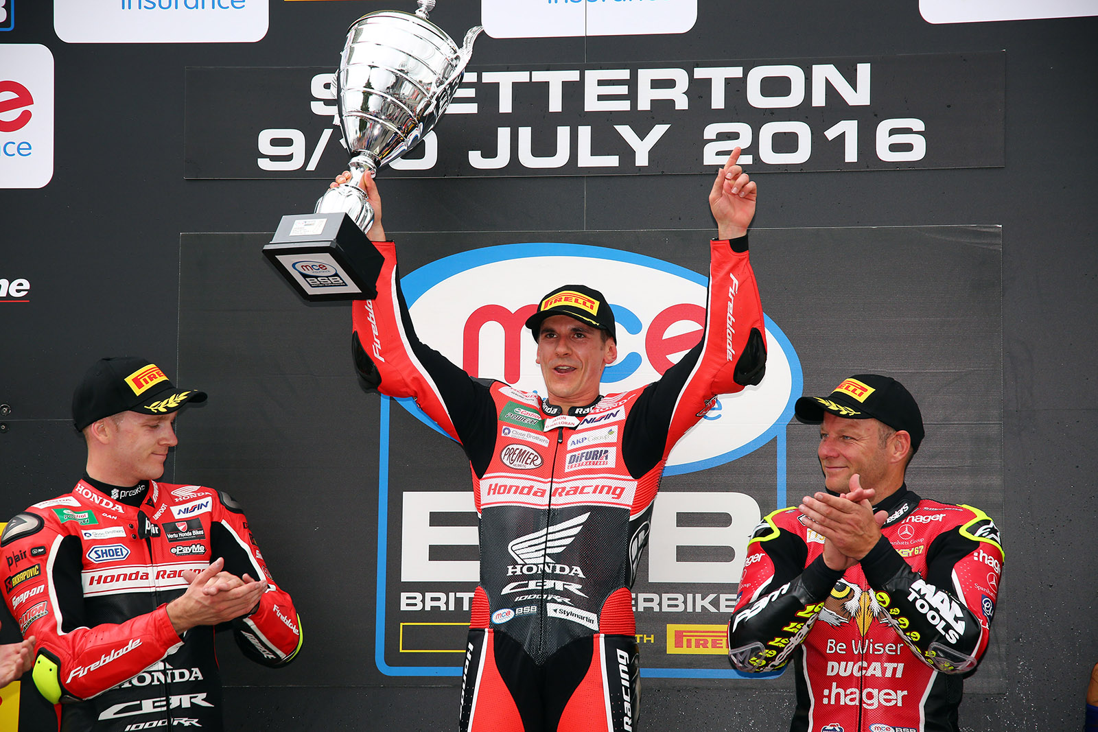 2016 British Superbike Championship, BSB R05, Snetterton, Norfolk. 10th July 2016. Jason O'Halloran, Australia, Honda Racing wins race 1 from Dan Linfoot, Knaresborough, Honda Racing and Shane Byrne, Sittingbourne, Be Wiser Ducati who came from last on lap one