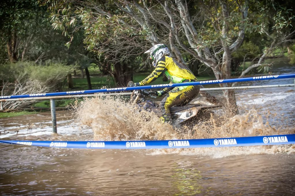 Beau Ralston wades his way through a water crossing at the final round of the AORC.