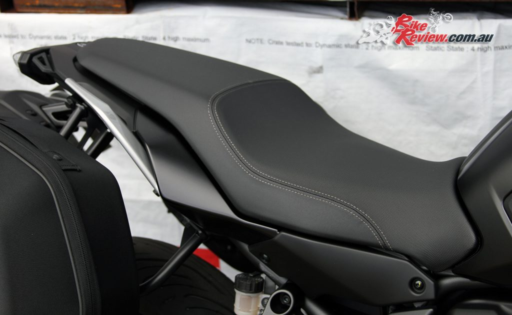A large comfortable seat gives the rider room to move around and an ideal perch for a pillion, with grab rails and rubber clad pillion 'pegs.