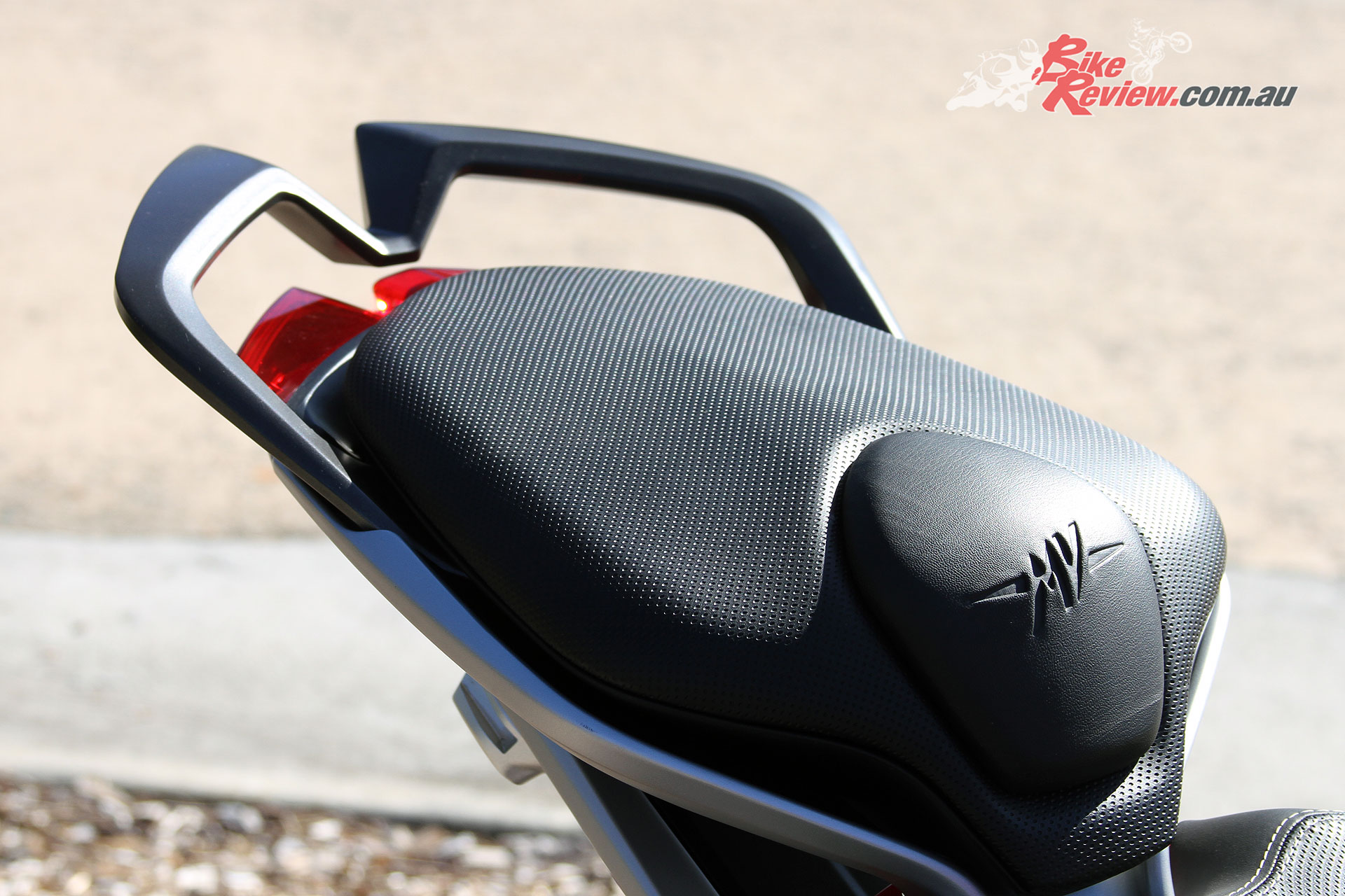 The stepped pillion seat gives them more leg room and a grab rail offers a point to hold onto, but does raise the pillion up behind the rider.
