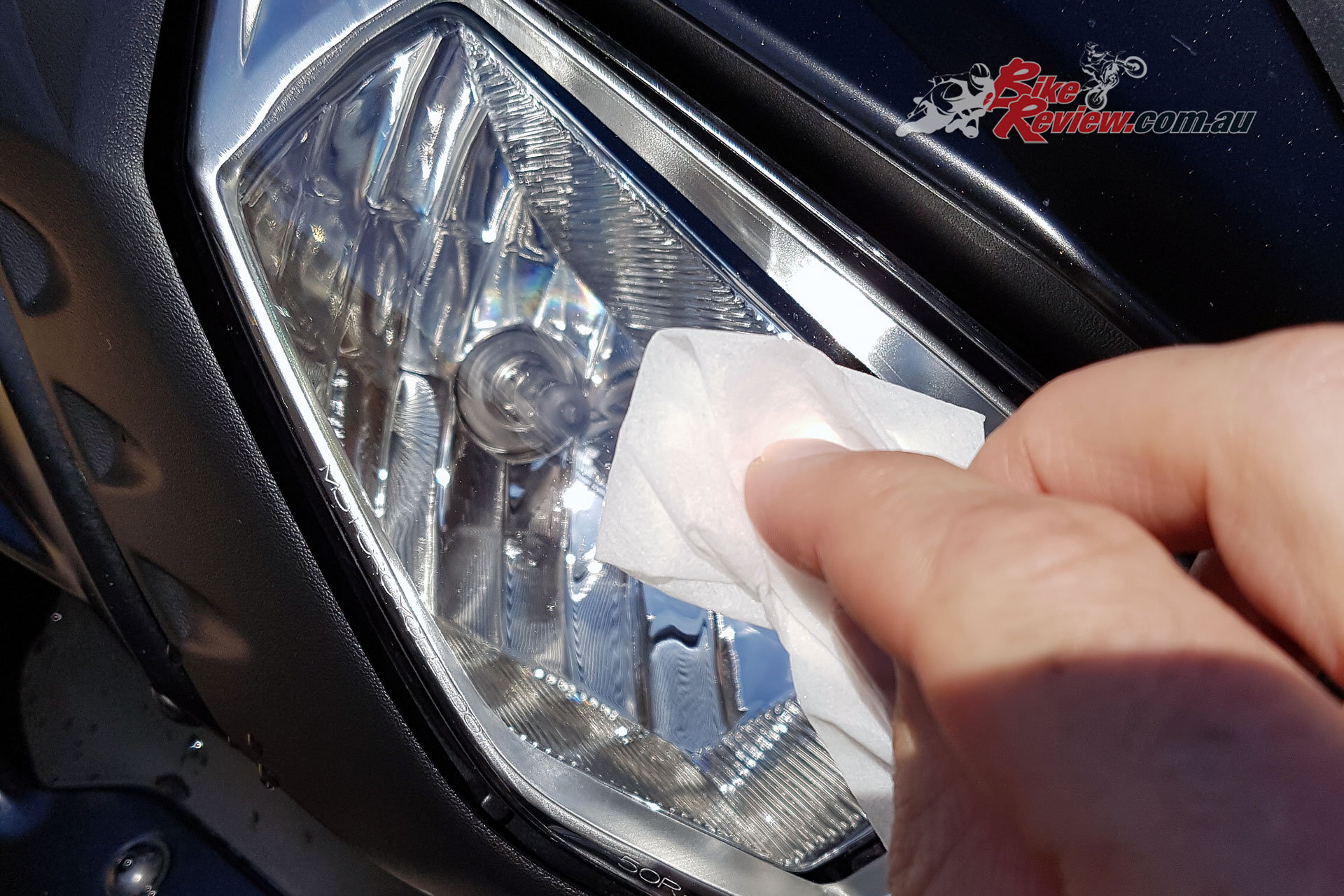Wiping down the headlight with the 3M VHB Surface Wipe