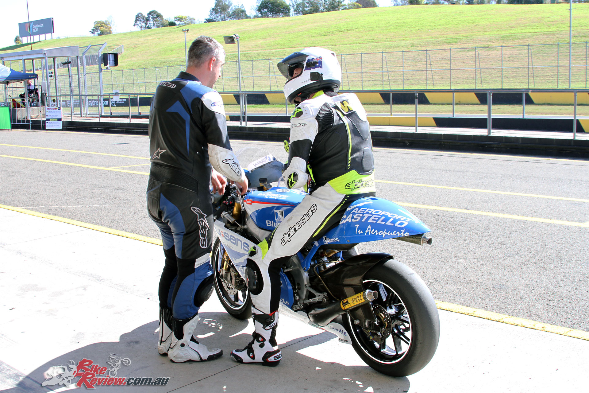 Warming up the Aprilia RSW250 GP machine at Eastern Creek