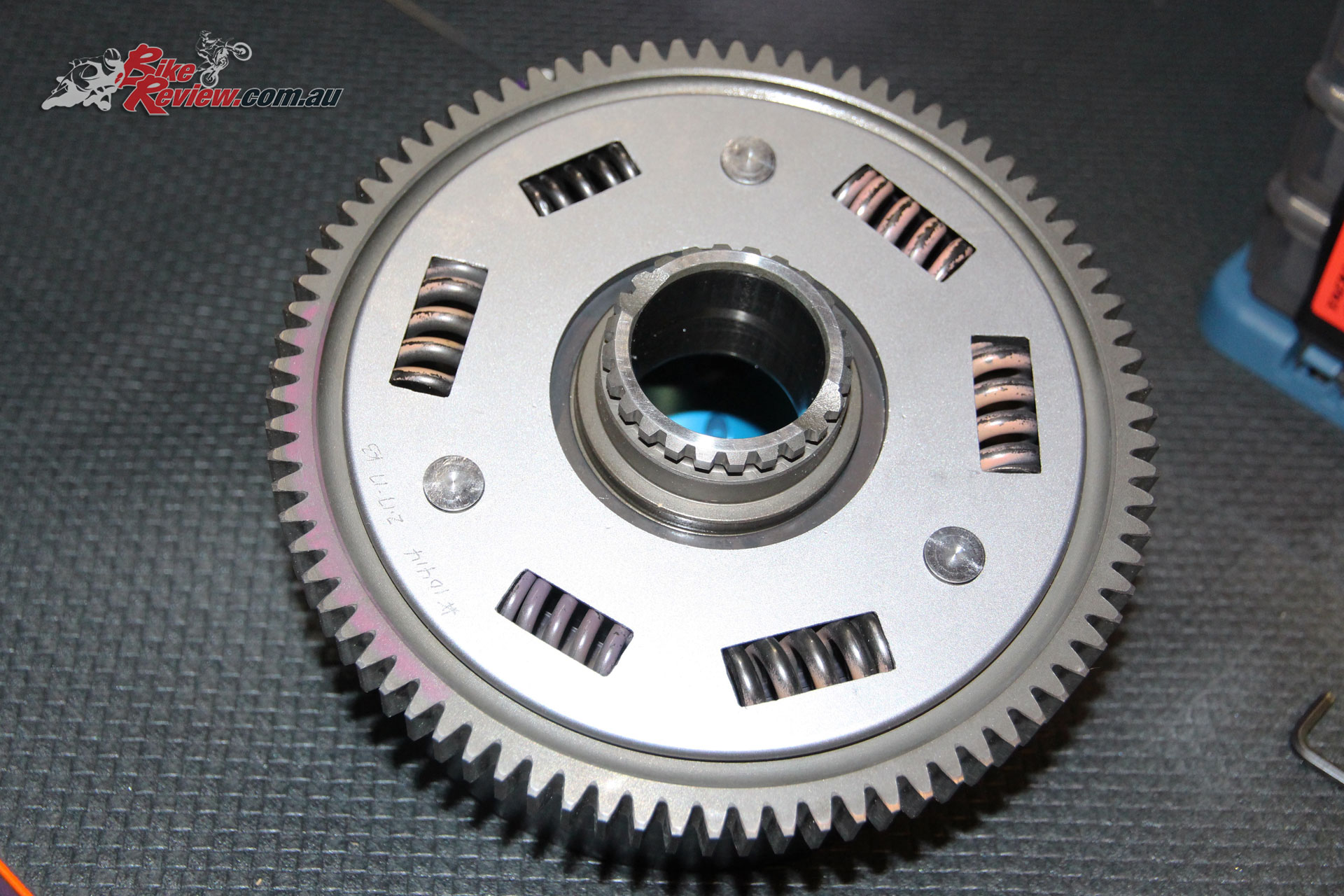 Original Suzuki drive gear. Fitted to MTC billet basket, complete with new springs.