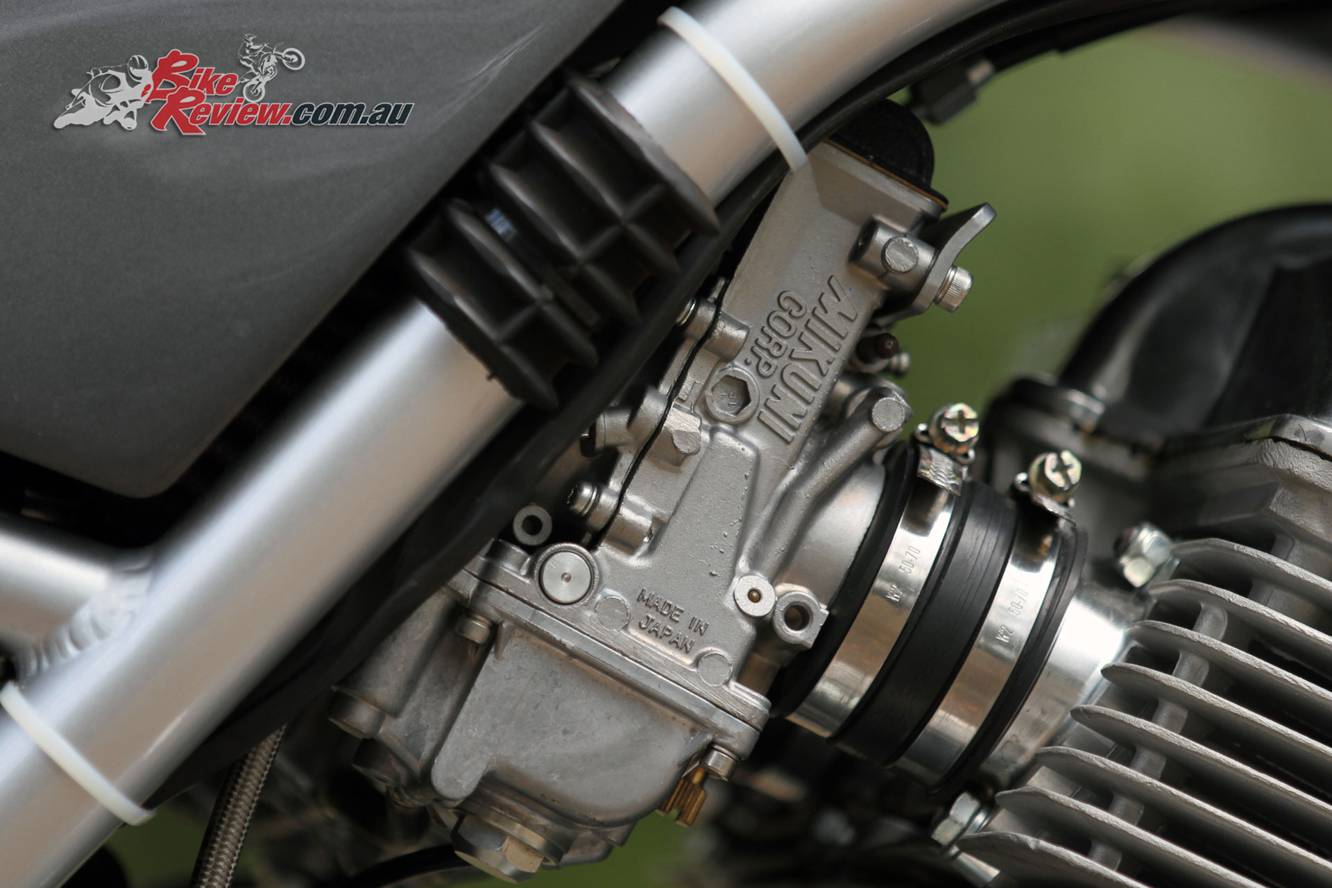 Mikuni RS 36mm Flatslide carburetors are modified from a four-cylinder Japanese machine to suit the triple