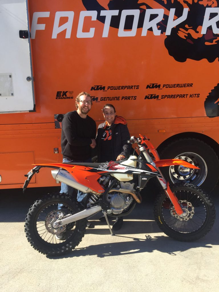 KTM Marketing Manager Alana Baratto hands the new 350 over. Do you reckon I look stoked?