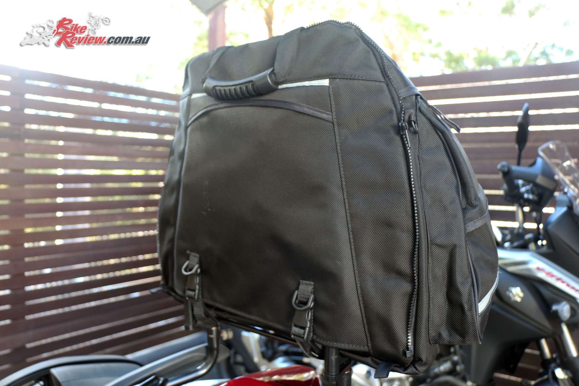 The bag slips into place and gets clipped down ensuring it won't go anywhere, the rear zip visible is for zipping a second bag into place for extra capacity