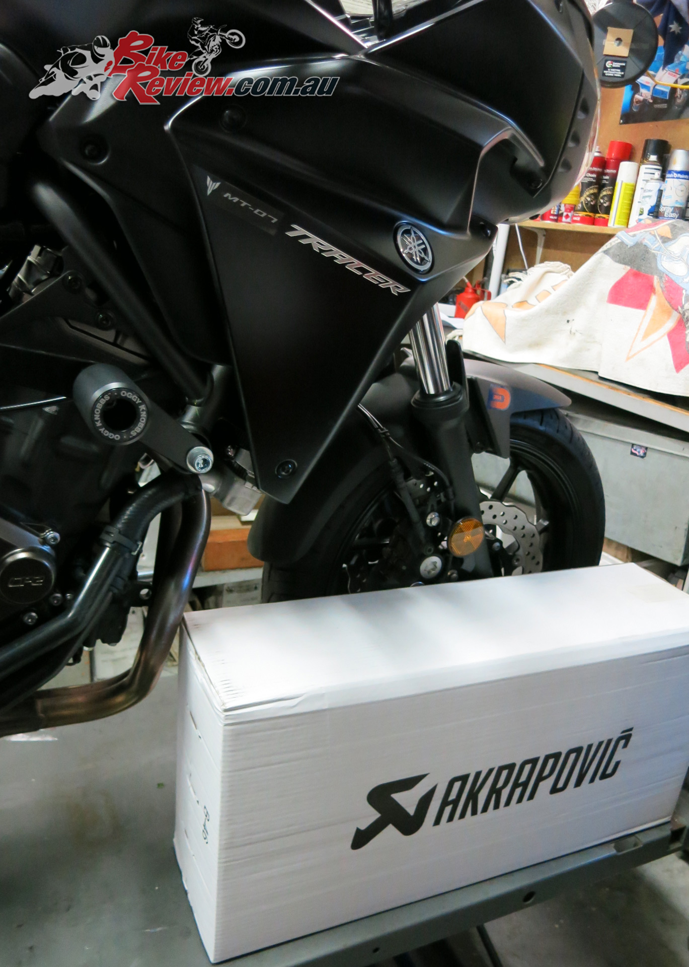 The excitement of a big box of motorcycling goodies!