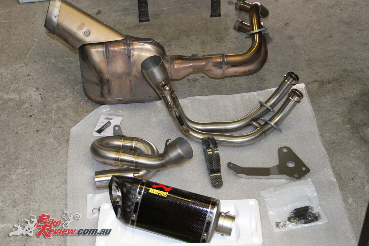 Old versus new. The MT-07 Tracer's standard exhaust weighed in almost 4kg heavier than the Akrapovic replacement.