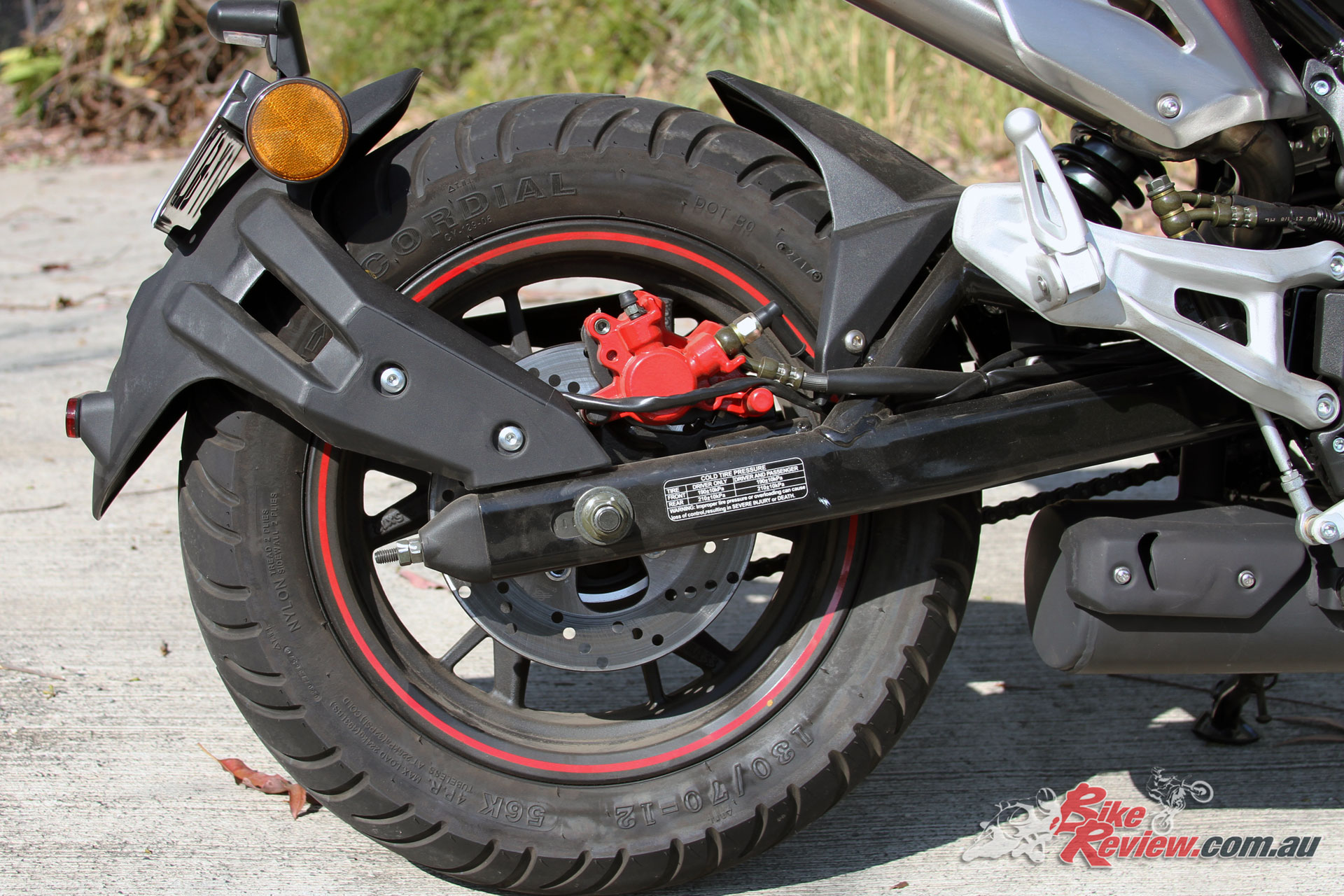 I'd convert the rear brakes to a traditional system. The swingarm mounted fender is also a cool touch, keeping the tail clean.