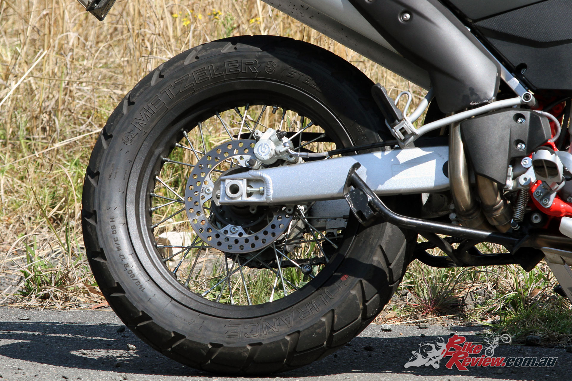 The rear brake carries the most bite of the system and is a Brembo offering like the front.