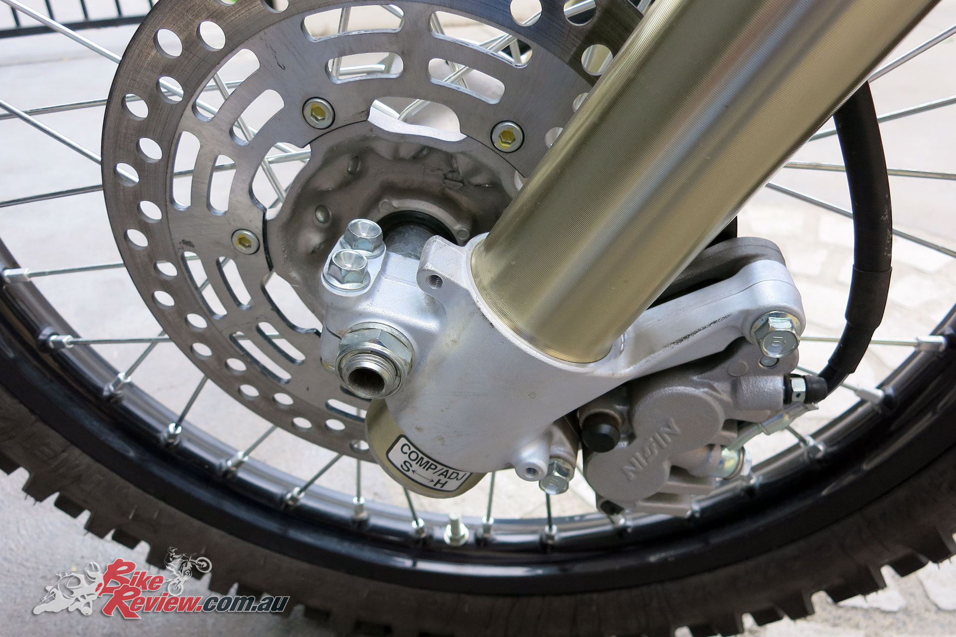 Conventional 49mm Showa telescopic forks are fully adjustable