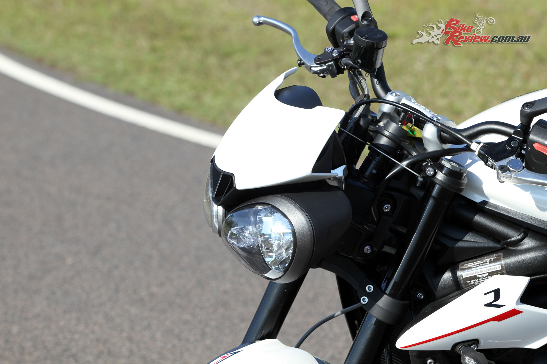 The new headlight cowl and mini-fairings include the 'R' designation and make for clean lines
