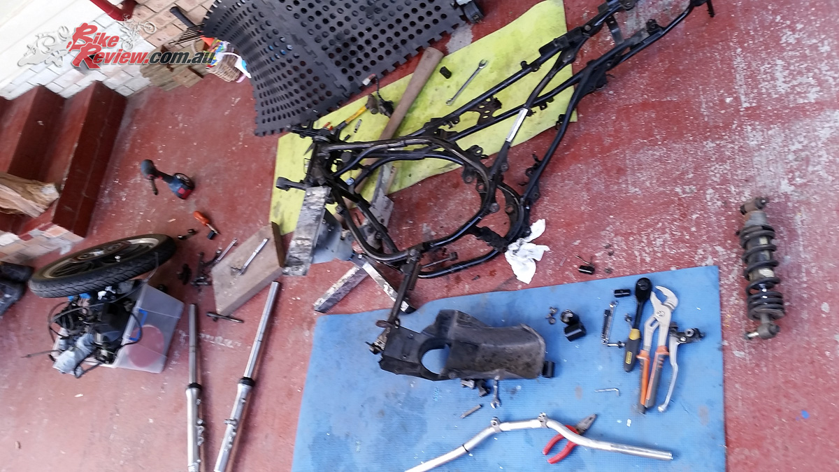 The bike was stripped down to the bare frame, once Pommie had planned out what he was going to do, taking careful note of what went where, and how.