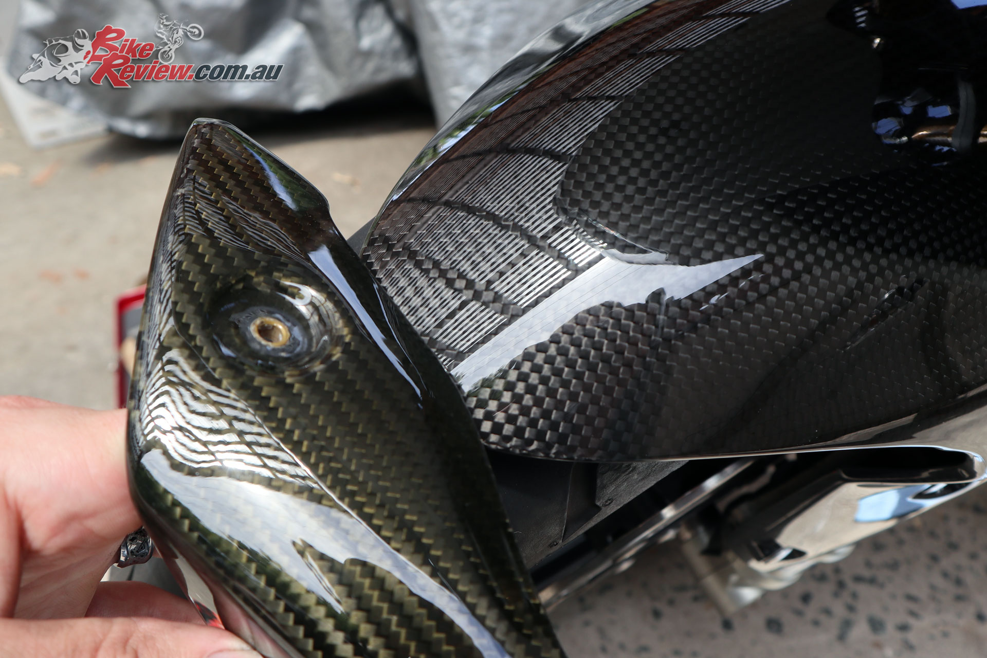 You can see how the eBay special carbon-fibre has not aged well, while the Triumph genuine looks like new