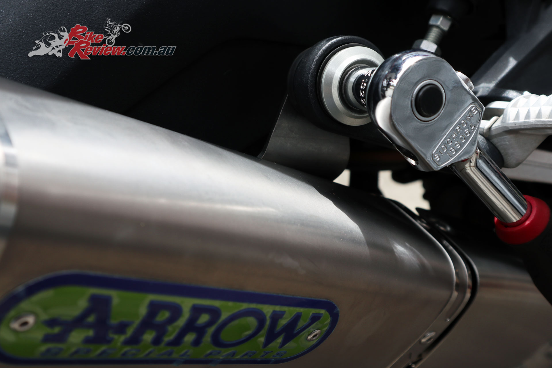 Add the bolt to the upper mounting point off the rearset, with the appropriate spacer and grommet.