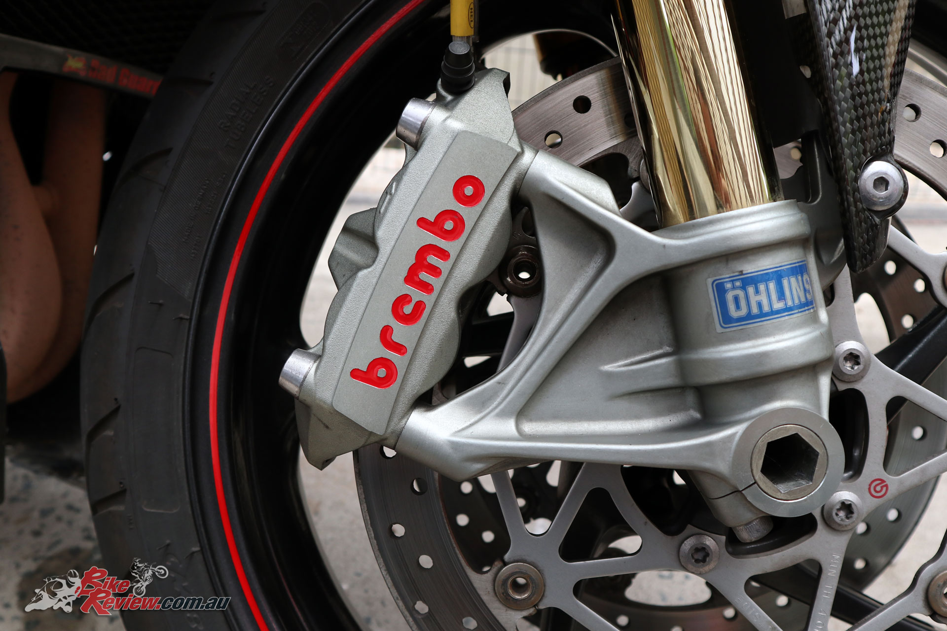 The Brembo calipers are monobloc items, and you can see the two mounting bolts.
