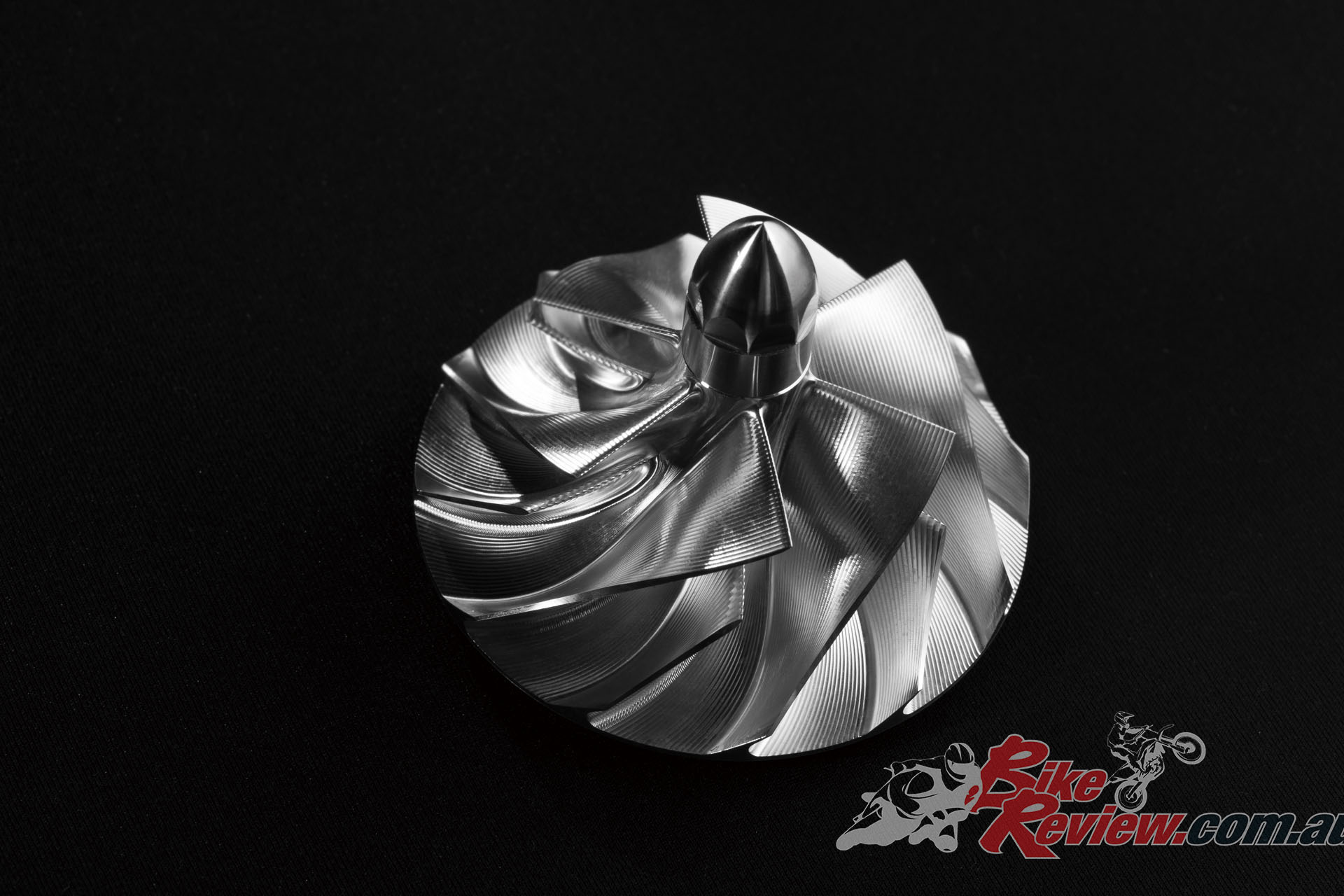 The supercharger impeller is formed of a forged aluminium and measures 69mm across.