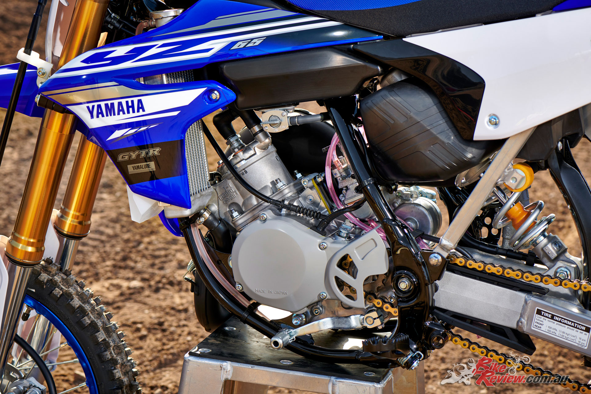 The YZ65's 64.8cc liquid-cooled, two-stroke engine