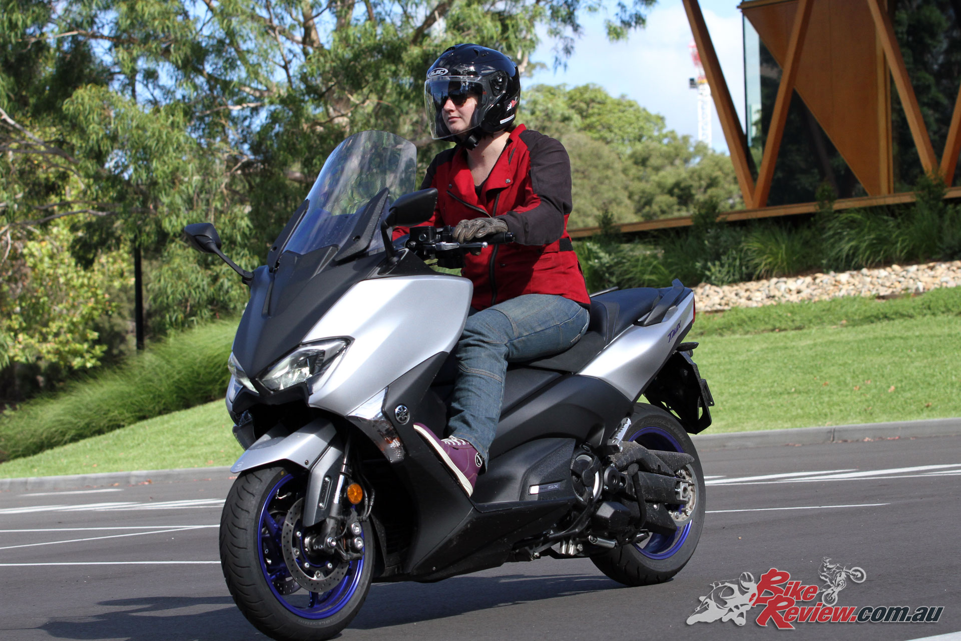 For motorcycle like performance in a scooter package, with some street cred, check out the TMax SX