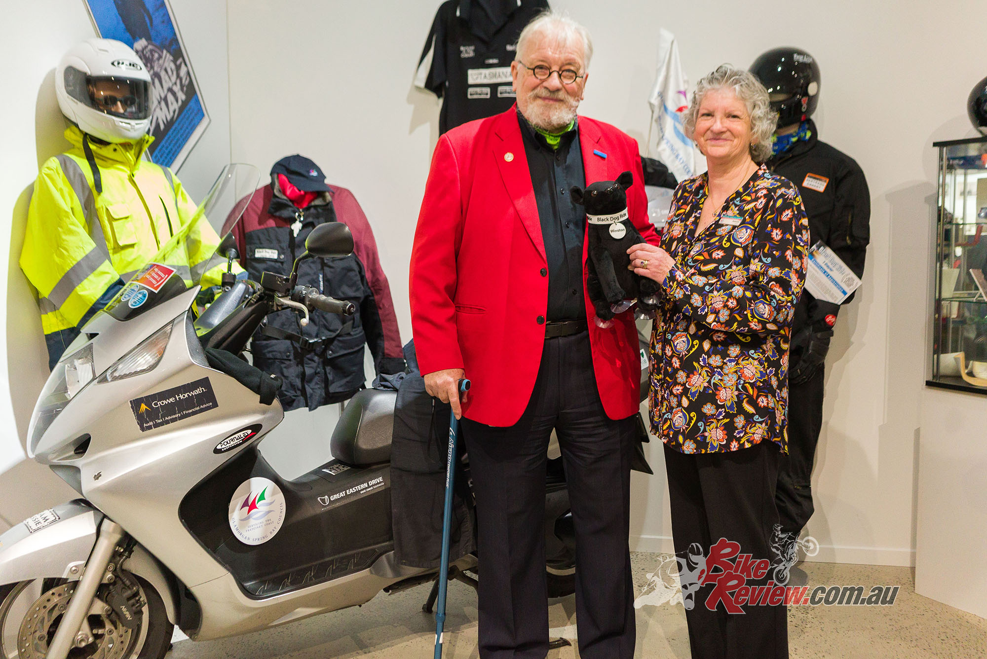 Bertrand regretfully hands over the Honda SilverWing to the director of the East Coast Heritage Museum. The scooter has 65,000km on the clock. Pic: Martin, Madhouse Photography