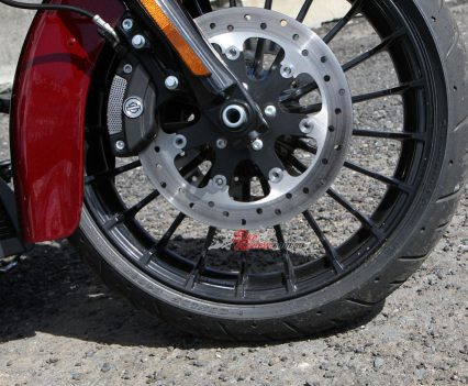 Dual 320mm rotors adorn the Road King with four-piston calipers featuring 32mm pistons