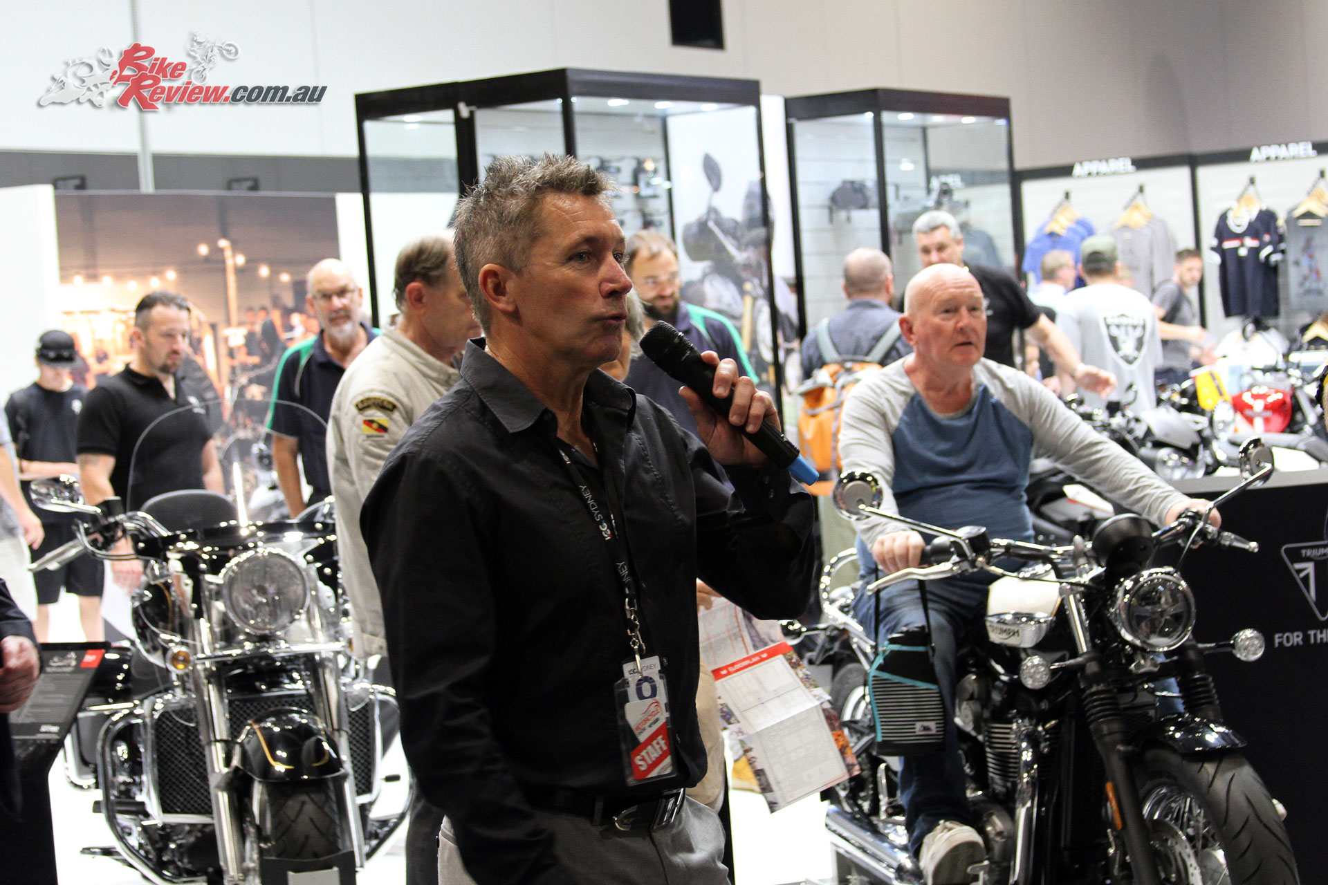 Troy Bayliss introduces the show in front of the Triumph stand
