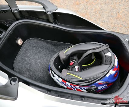 Plenty of room to spare with a full face in the TMax SX's underseat storage