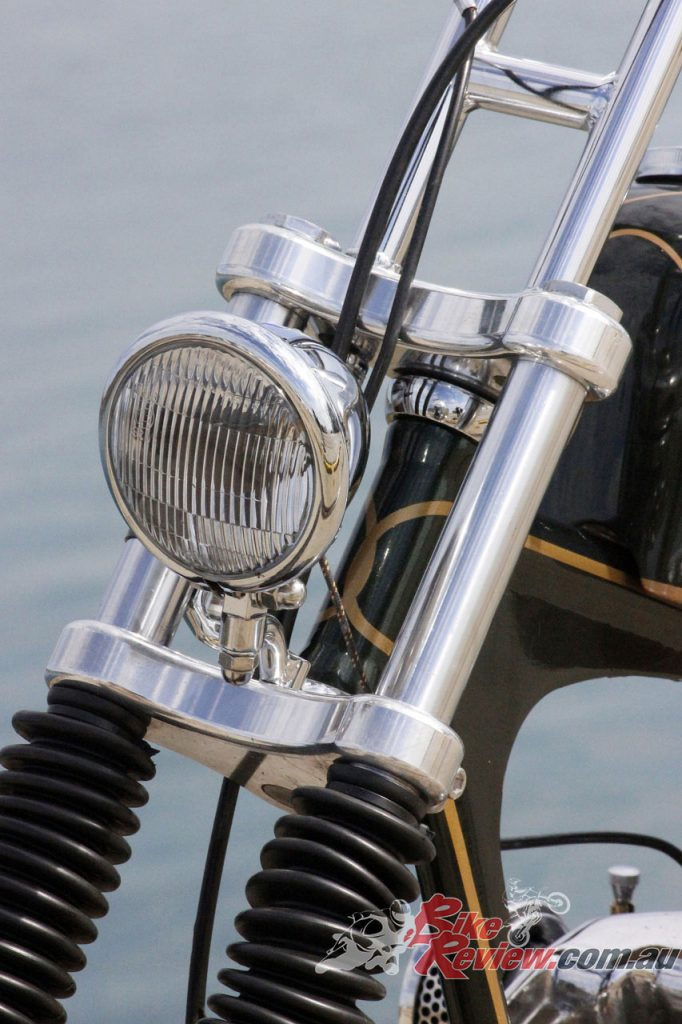 The forks are stock with narrow Mullins triple-clamps pinching them. The headlight is a Bates mini.