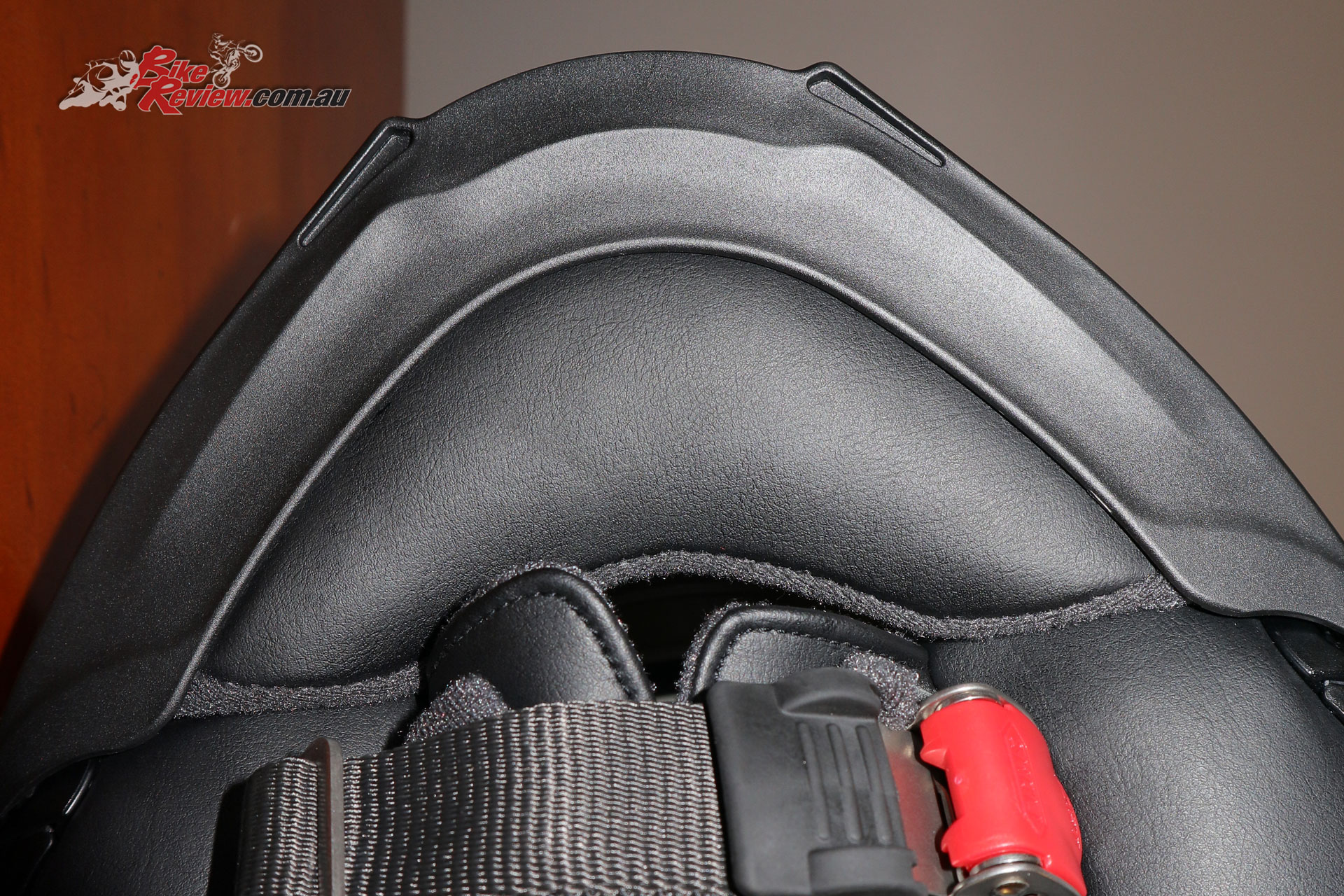 The chin protector in the chin of the Neotec II. It can be removed but is essential for the Sena SRL to keep the mic in still air.
