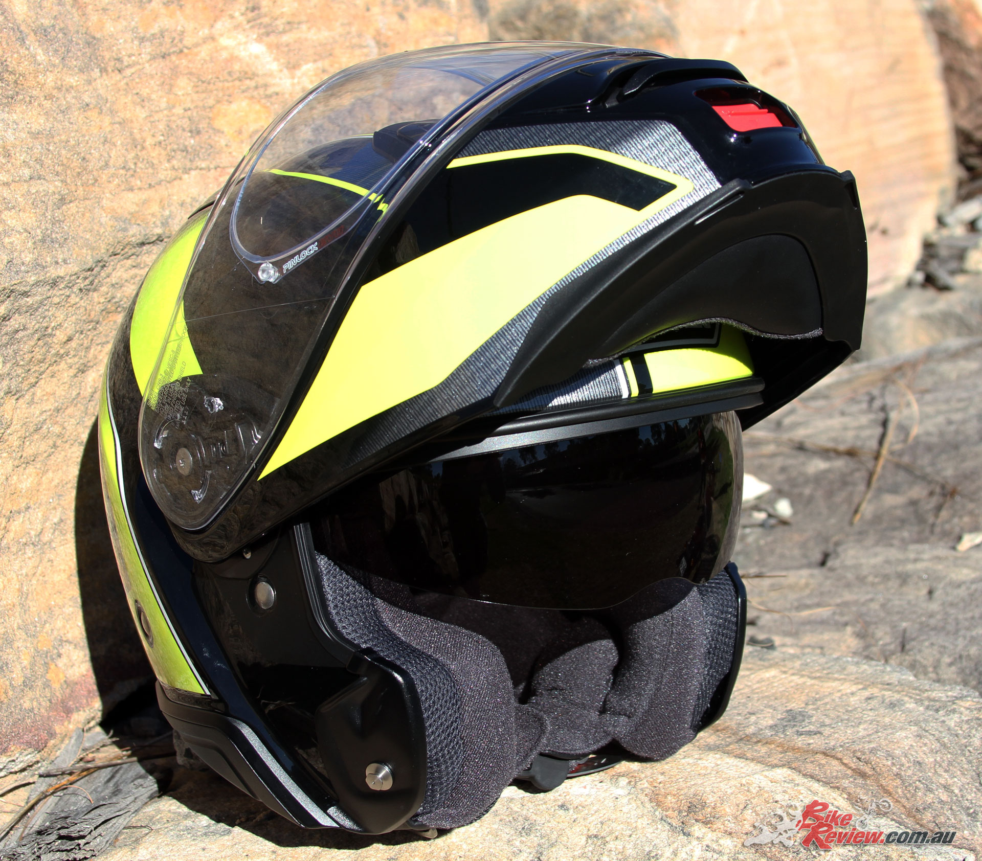 The Neotec II with the chin flipped up and internal sun visor extended.