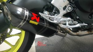 Slide the muffler into place including the muffler bracket also in carbon-fibre.