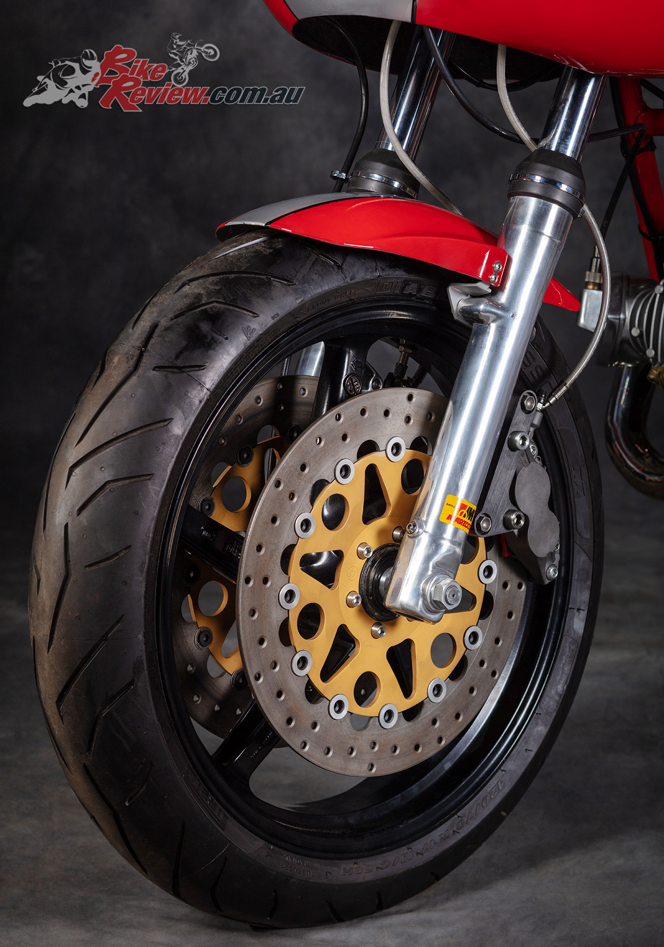 Full floating Brembo race rotors squeezed by Brembo four-piston calipers