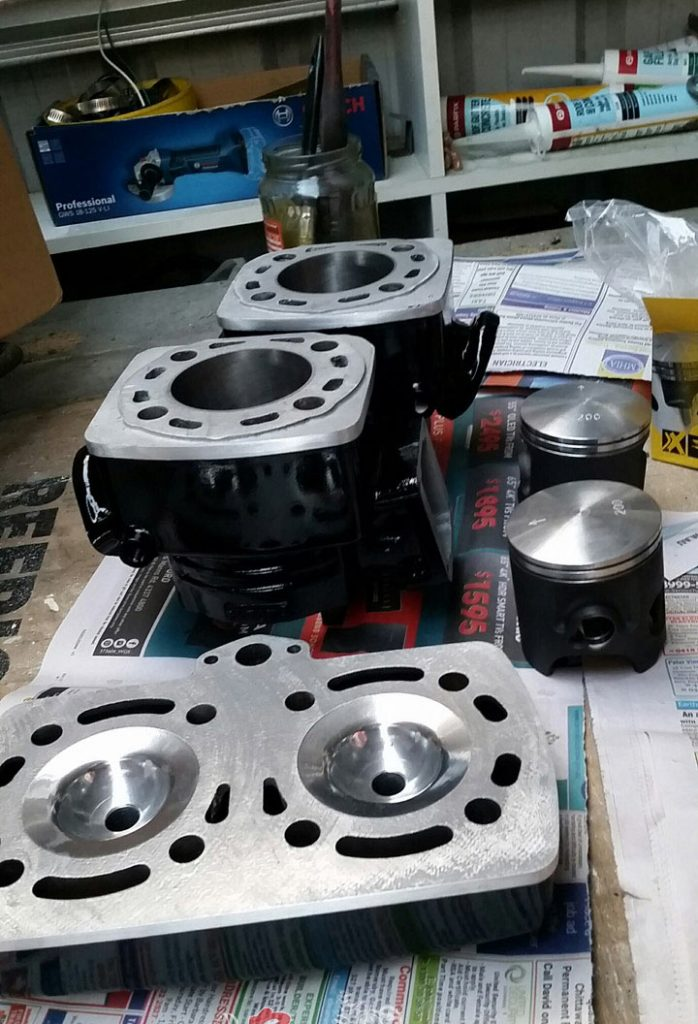 Barrels were bored to oversize, new pistons and ring, ported and polished and head skimmed.