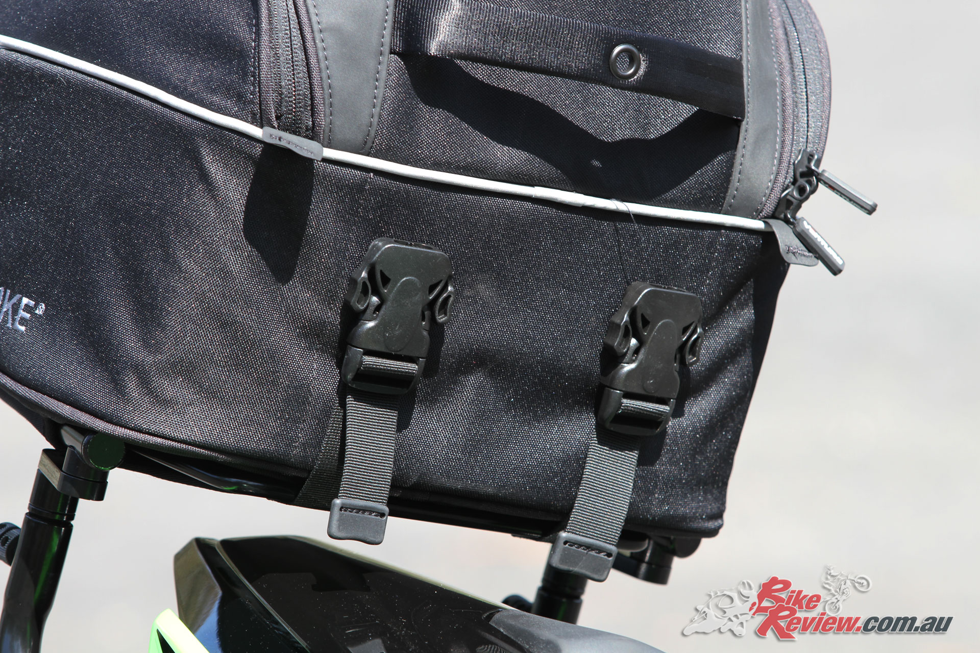These quick release buckles are seriously heavy duty, meaning the bag won't be coming loose if secured properly, but requires a bit of strength to release.