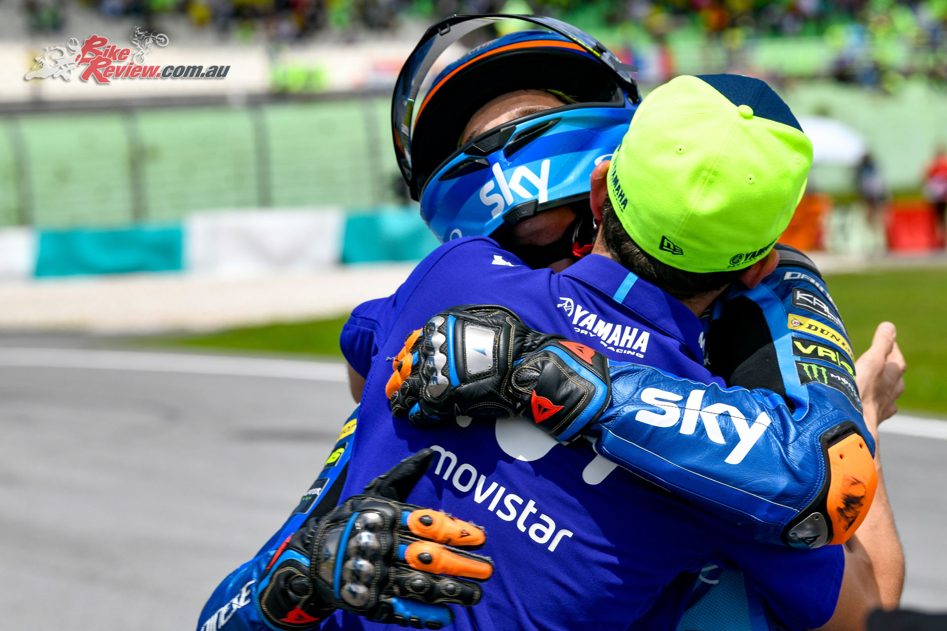 Luca Marini congratulated by Rossi