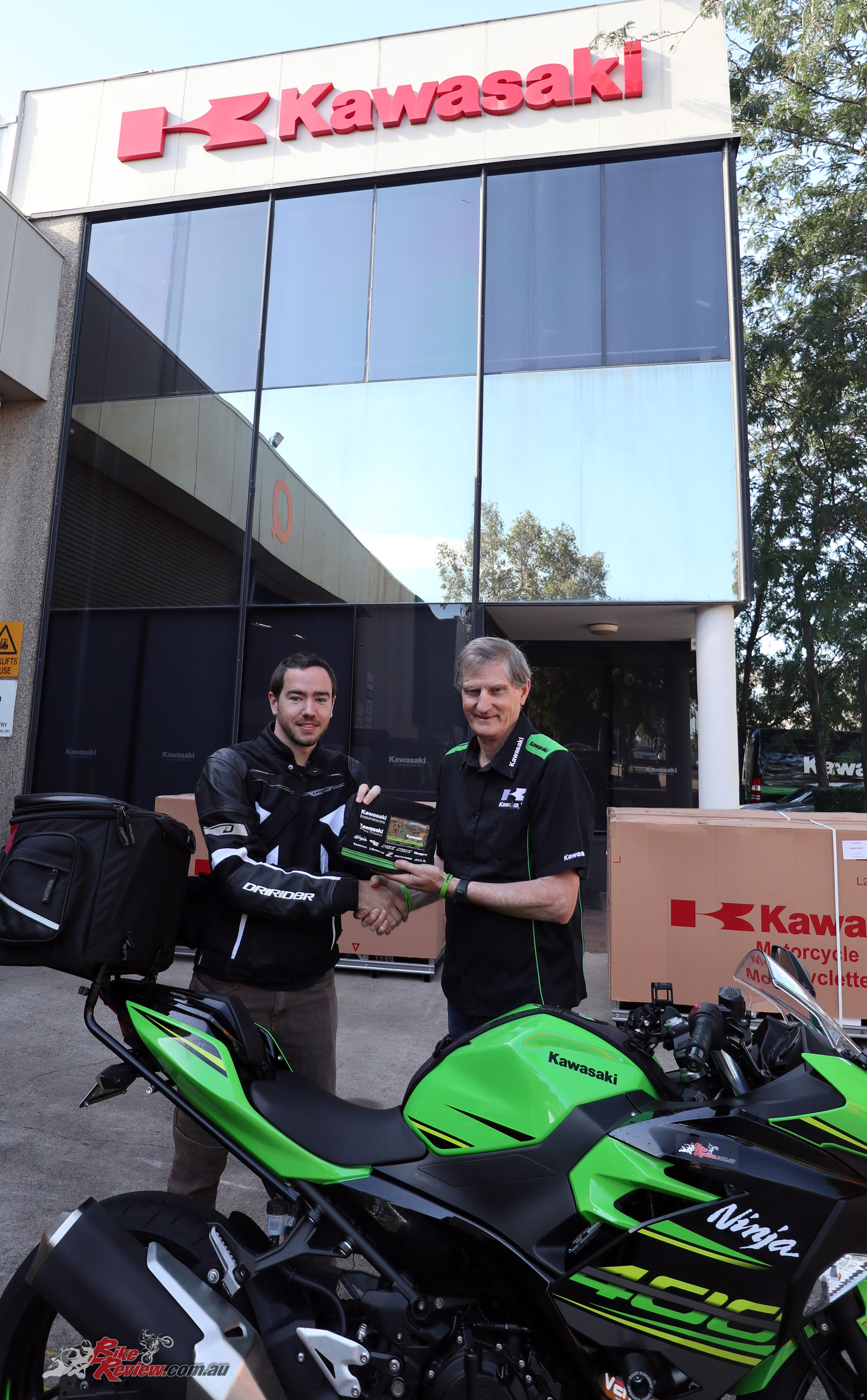 Kris receiving the Project Ninja 400 keys from Murray Sayle at Kawasaki HQ in Sydney