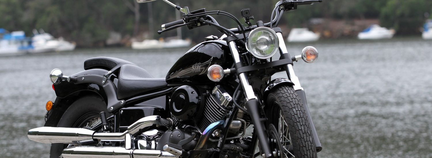 The Yamaha V-Star 650 Custom (XVS650) is a fairly traditional cruiser offering with 'Raven' paint punctuated by chrome