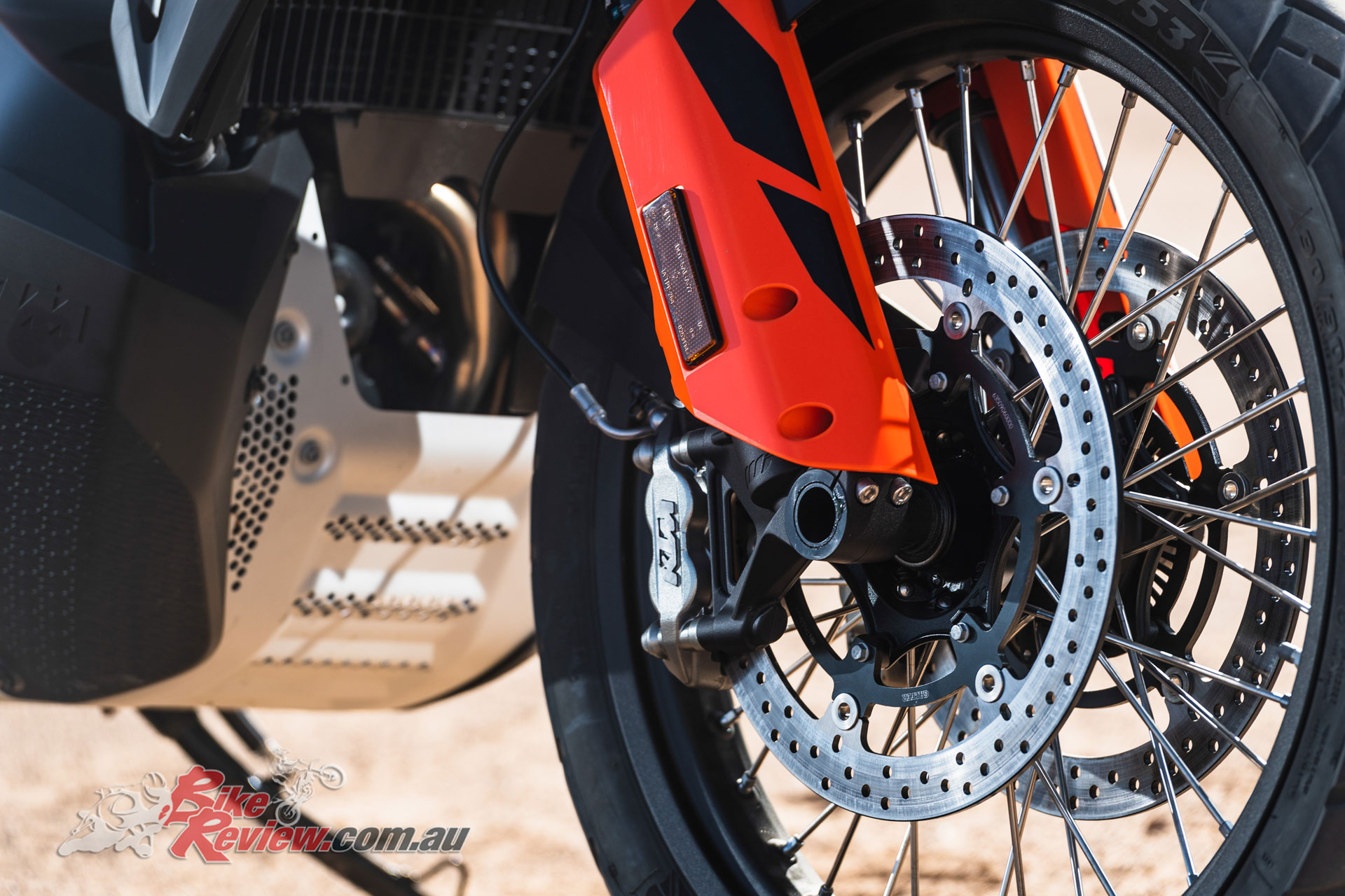Front brakes are dual 320mm rotors with four-piston calipers, and a 21in front wheel