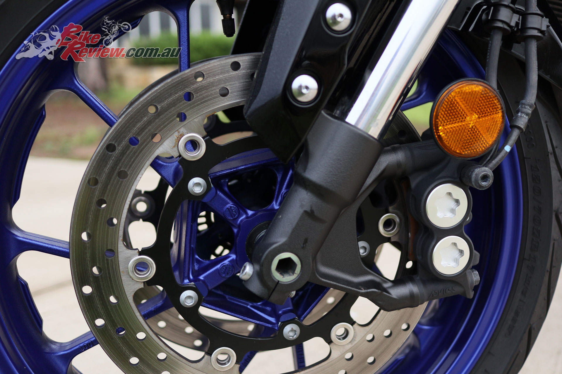 Dual 298mm rotors on the Tracer 900 GT are slowed by four-piston calipers