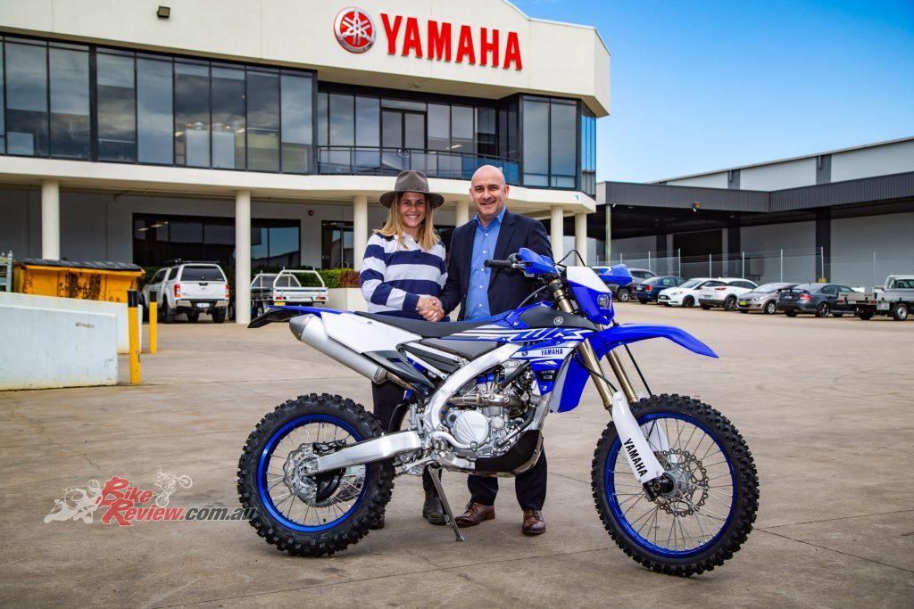 Yamaha Motor Australia CFO Darryl Lovegrove hands the WR250F to Yamaha Day competition winner Nicola Theile.