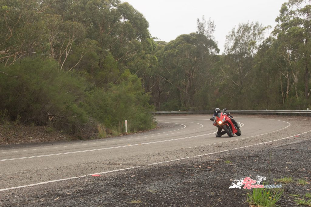 Wearing my Dad's old leathers and getting my knee down on the old road, on my small Honda CBR300R.