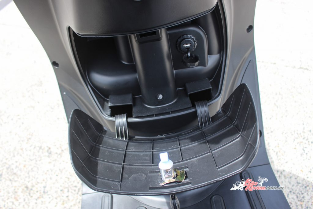 Storage compartment which holds plenty of space for a phone, wallet, keys, etc. and includes a USB socket.