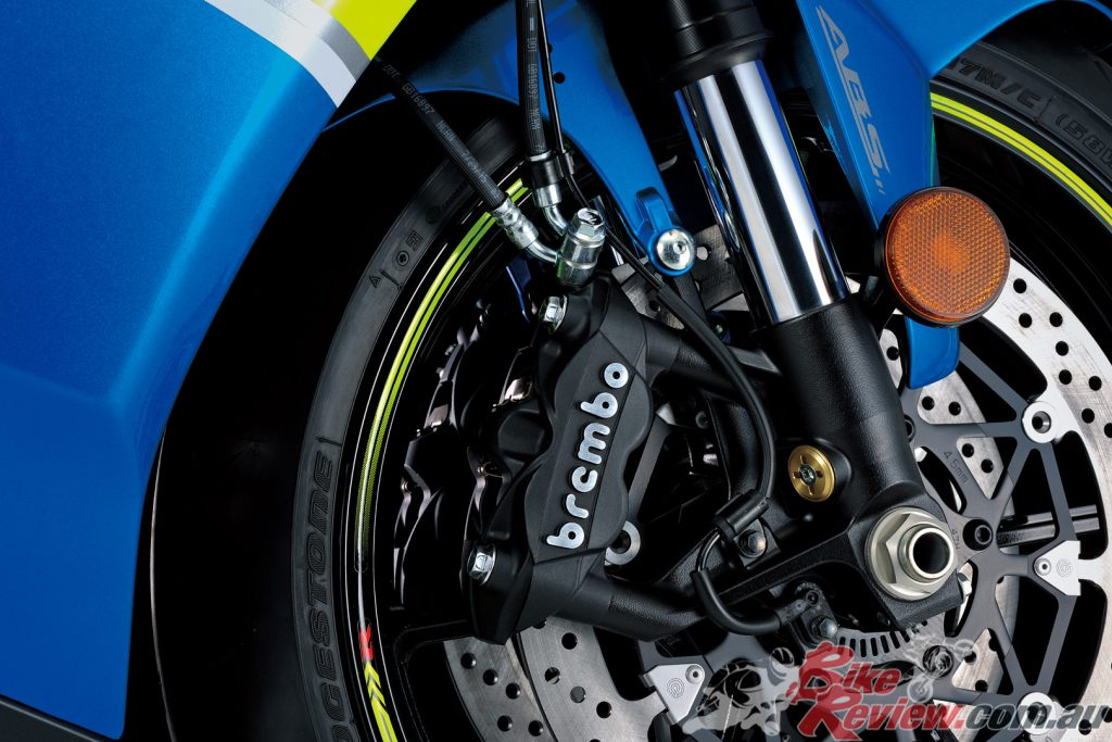 Radial-mount Brembo monobloc calipers matched with hybrid floating/T-drive 320mm Brembo discs.