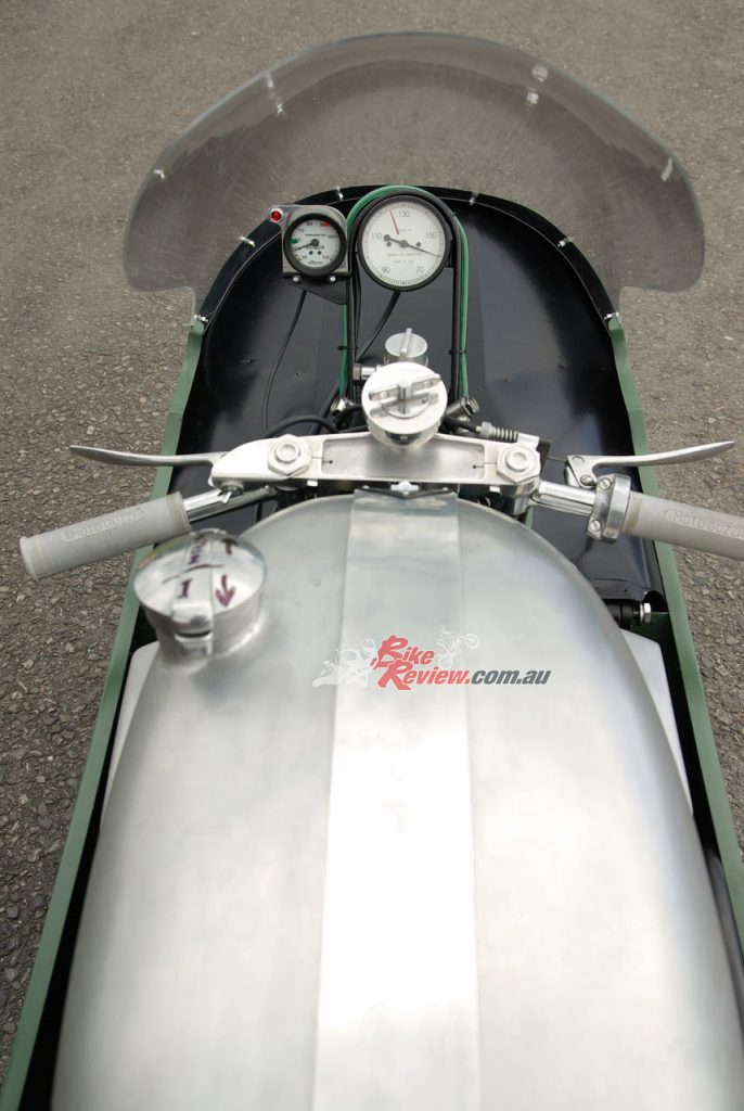 """""""An astronomic 15,000rpm, with a red line painted at the safe 12,500rpm redline which Guzzi V8 riders were asked to observe, flanked on the left by a small Acqua temp gauge with a dab of green paint at 60º and a red one at 90º""""."""